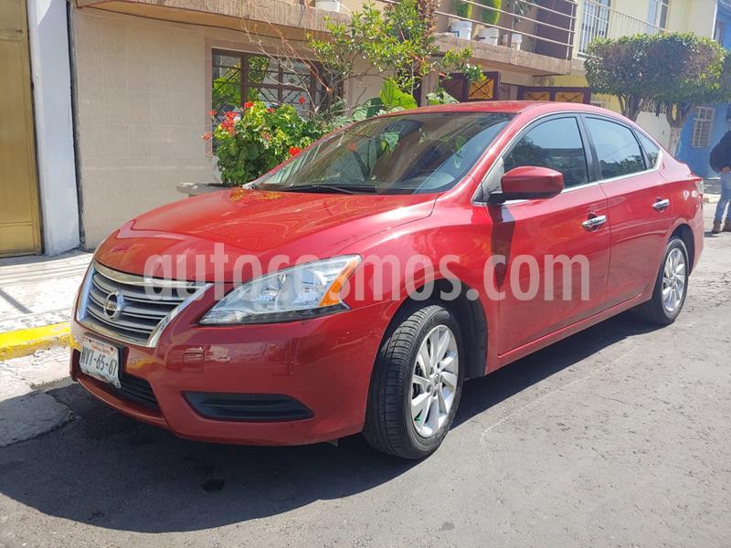 Nissan Sentra Sense Aut usado (2013) color Rojo Burdeos precio $122,000