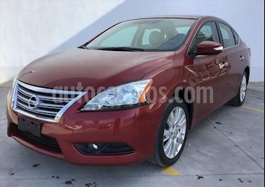 Nissan Sentra Exclusive NAVI Aut usado (2016) color Rojo precio $210,000