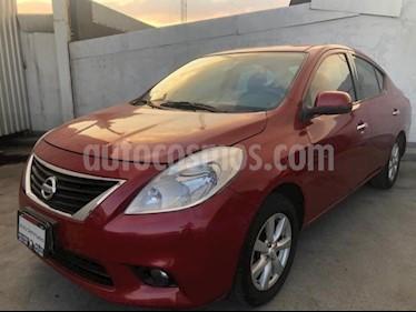 Nissan Versa 4P ADVANCE TM5 A/AC. VE F. NIEBLA RA-15 usado (2014) color Rojo precio $130,000