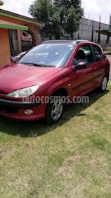 Foto venta Auto usado Peugeot 206 3P XR 1.4 Presence Equipado (2002) color Rojo precio $35,000