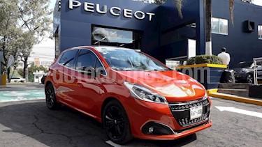 Foto venta Auto Seminuevo Peugeot 208 1.6L Feline Aut (2016) color Naranja precio $209,900