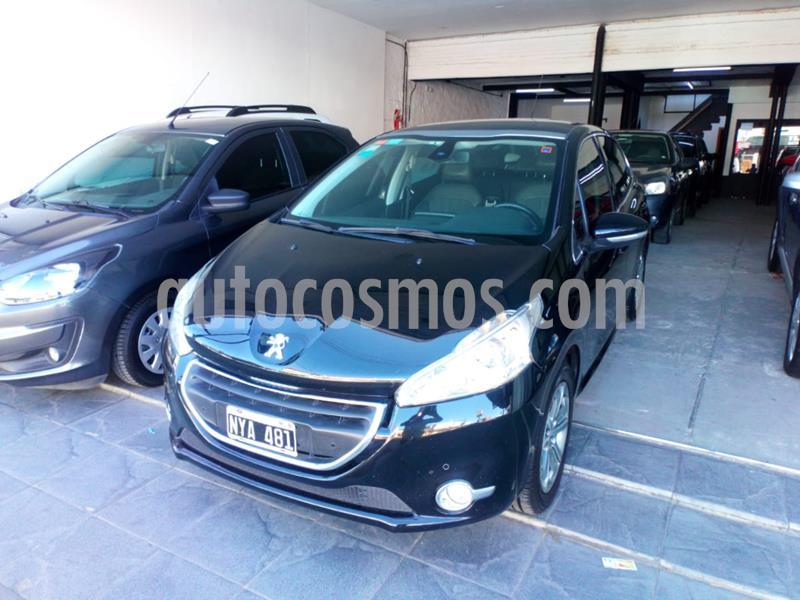 Peugeot 208 Feline 1.6 Pack Cuir usado (2014) color Negro precio $590.000