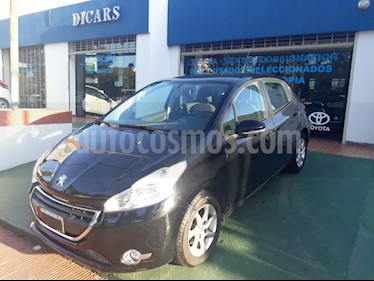 Peugeot 208 Active 1.5  usado (2013) color Negro precio $550.000