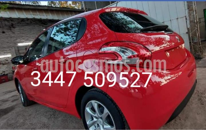 Peugeot 208 Allure 1.5 Full  usado (2013) color Rojo Lucifer precio $930.000