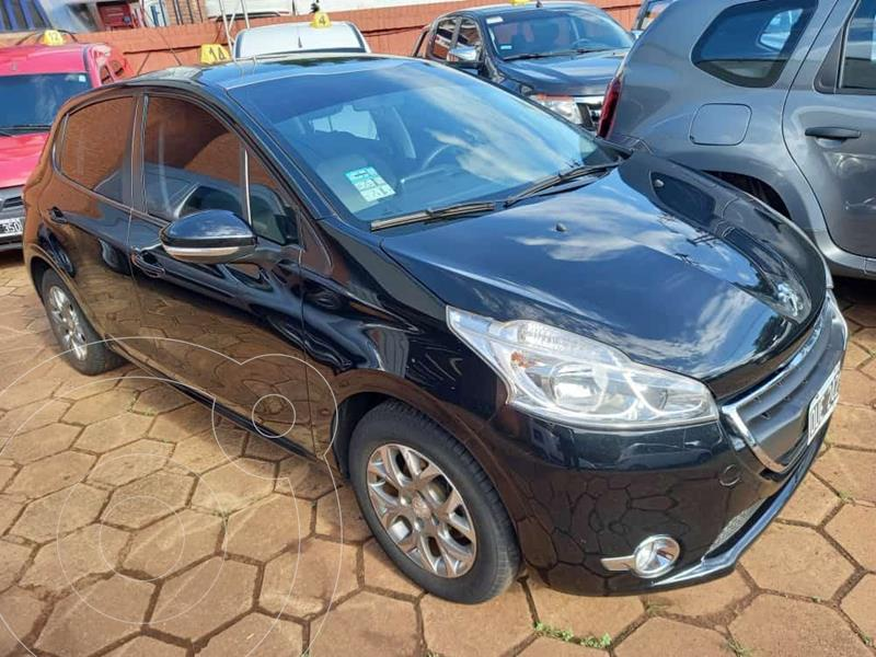 Peugeot 208 Allure 1.5 N 5p Touch Screen usado (2015) color Negro precio $1.200.000