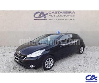 Peugeot 208 Active 1.5  usado (2013) color Negro precio $578.000