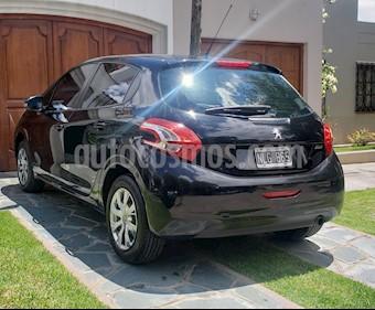 Peugeot 208 Active 1.5  usado (2013) color Negro precio $380.000