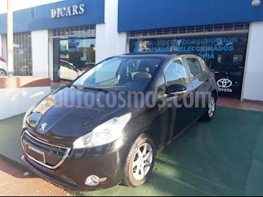 Peugeot 208 Active 1.5  usado (2013) color Negro precio $450.000