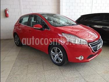 Foto venta Auto usado Peugeot 208 Feline 1.6 Pack Cuir (2014) color Rojo precio $405.000