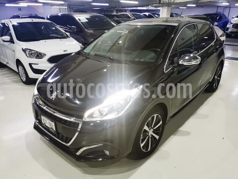 Peugeot 208 1.6L Feline usado (2017) color Negro precio $184,100