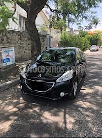 Peugeot 208 1.6L Allure usado (2015) color Negro Perla precio $130,000