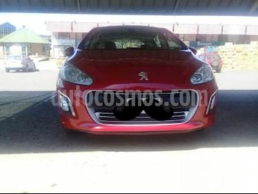foto Peugeot 308 Allure usado (2015) color Rojo precio $480.000