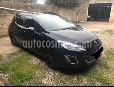 Peugeot 308 Feline HDi usado (2012) color Negro precio $643.000