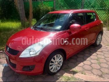 Foto Suzuki Swift GLS usado (2013) color Rojo precio $117,000