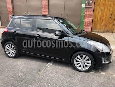 Foto venta Auto usado Suzuki Swift GLX (2015) color Negro precio $132,900