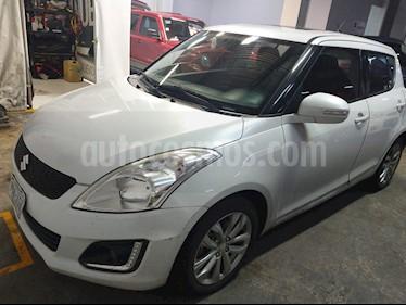 Foto Suzuki Swift GLX usado (2014) color Blanco precio $145,000