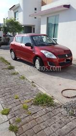Suzuki Swift GA usado (2016) color Rojo Rock precio $120,000