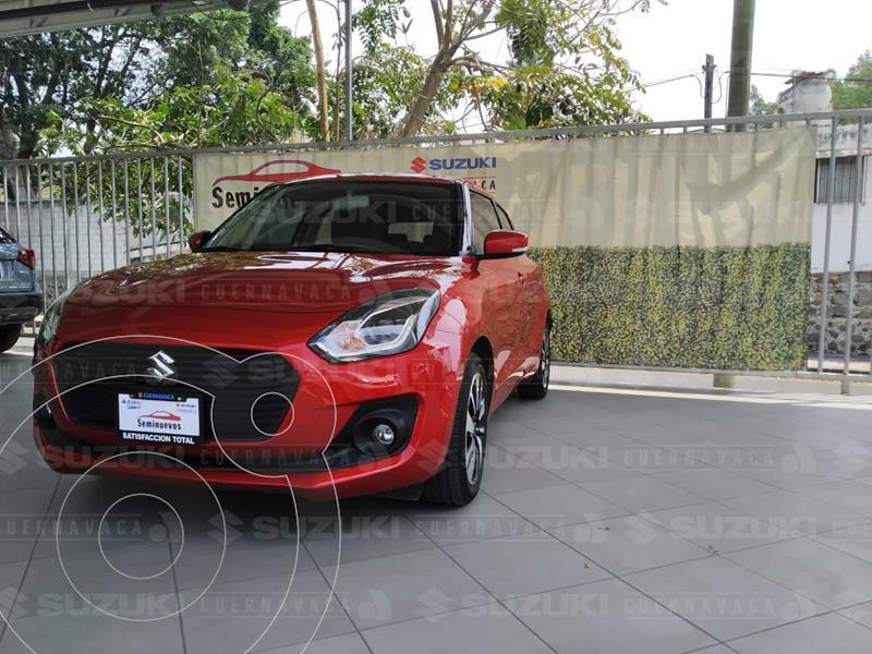 Foto Suzuki Swift GLX usado (2020) color Rojo precio $260,000