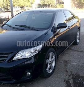 Foto Toyota Corolla 1.8 XEi usado (2013) color Negro precio $360.000