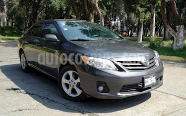 Foto Toyota Corolla 4P XLE 1.8L TA A/AC. VE CD ABS RA 16 usado (2013) color Gris precio $150,000