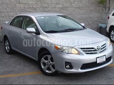Foto Toyota Corolla 4P XLE 1.8L TA A/AC. VE CD ABS RA 16 usado (2013) color Plata precio $135,000