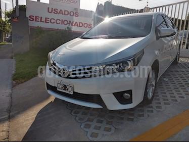 Toyota Corolla 1.8 XEi usado (2014) color Blanco precio $590.000