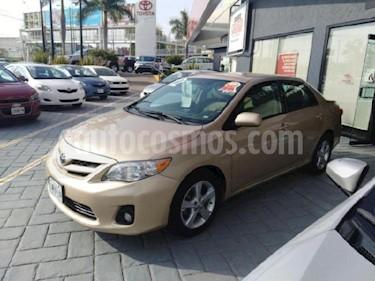 Foto Toyota Corolla GLi  usado (2012) color Dorado precio u$s11.000