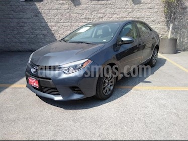 Toyota Corolla 4P BASE TM6 A/AC. BL R-16 usado (2014) color Gris precio $148,000