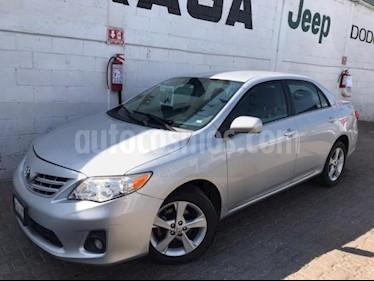 foto Toyota Corolla 4P XLE 1.8L TA A/AC. VE CD ABS RA 16 usado (2013) color Plata precio $150,000