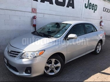 Toyota Corolla 4P XLE 1.8L TA A/AC. VE CD ABS RA 16 usado (2013) color Plata precio $150,000