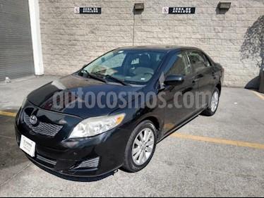 Toyota Corolla 4P XLE 1.8L TA A/AC. VE CD ABS RA 16 usado (2009) color Negro precio $90,000