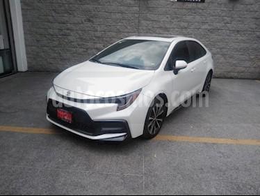 Toyota Corolla 4P SE 2.0L. TA A/AC. AUT. F. LED QC RA-17 usado (2020) color Blanco precio $370,000
