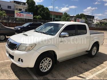 Toyota Hilux 3.0 4x2 SRV TDi DC Cuero usado (2014) color Blanco precio $1.600.000