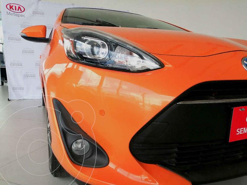 Foto Toyota Prius C 1.5L usado (2019) color Naranja precio $339,900