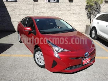 Toyota Prius 5P HB PREMIUM HIBRIDO TA PIEL GPS usado (2017) color Rojo precio $325,000