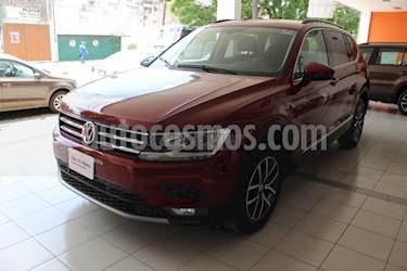 foto Volkswagen Tiguan Comfortline 7 Asientos Tela usado (2018) color Rojo Rubí precio $398,000