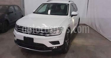 Volkswagen Tiguan 5p Confortline L4/1.4/T Aut Piel usado (2019) color Blanco precio $349,900