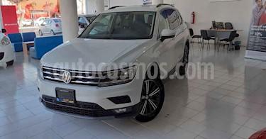 Volkswagen Tiguan 5p Confortline L4/1.4/T Aut Piel usado (2019) color Blanco precio $357,800