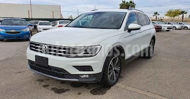 Volkswagen Tiguan 5p Confortline L4/1.4/T Aut Piel usado (2019) color Blanco precio $329,900