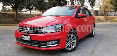 Volkswagen Vento 4P HIGHLINETM5 CLIMATRONIC VE MP3 RA-15 usado (2016) color Rojo precio $149,000