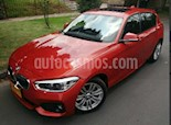 Foto venta Carro usado BMW Serie 1 116i 5P Aut (2016) color Naranja precio $70.900.000