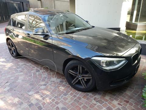 BMW Serie 1 118i Sport Line 5P Aut usado (2013) color Negro precio u$s17.000