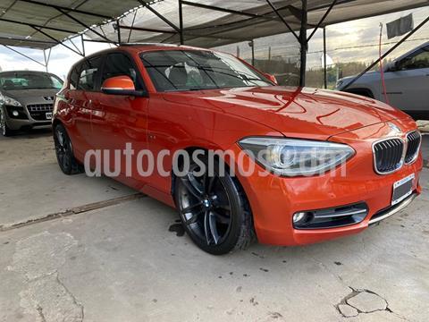 BMW Serie 1 118i Sport Line 5P Aut usado (2013) color Naranja precio u$s19.000