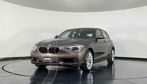 BMW Serie 1 5P 118iA usado (2014) color Cafe precio $213,999
