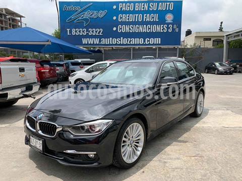 foto BMW Serie 3 320iA Luxury Line usado (2013) color Negro precio $239,900