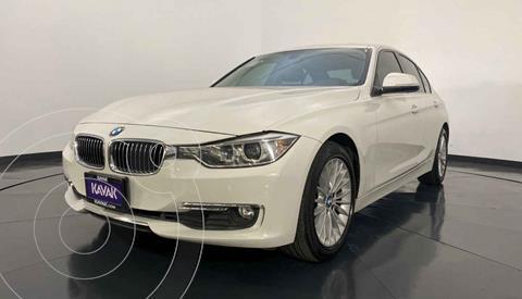 BMW Serie 3 328iA usado (2013) color Blanco precio $249,999