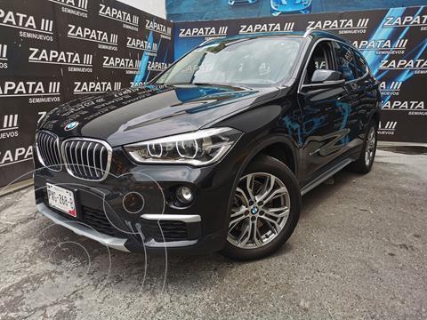 BMW X1 sDrive 20iA usado (2016) color Negro financiado en mensualidades(enganche $91,250 mensualidades desde $13,862)