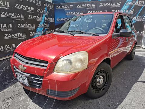 Chevrolet Chevy 5P Paq B usado (2010) color Rojo Merlot precio $85,000