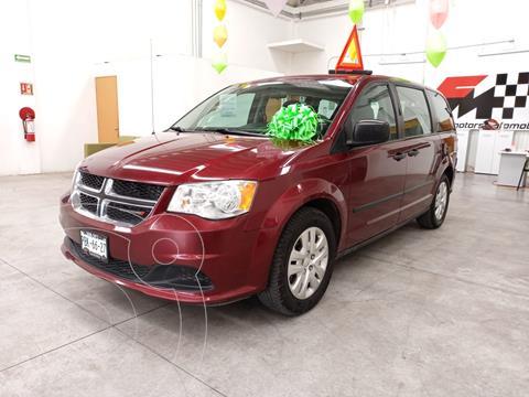Dodge Grand Caravan 5 pts. SXT Plus, TA, DVD, VE, piel, f. niebla, R usado (2017) color Rojo precio $285,000