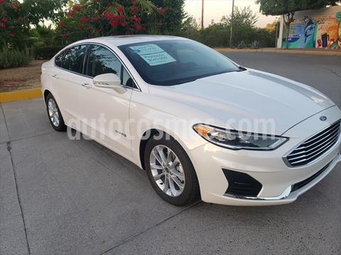 Ford Fusion SE LUX Hibrido usado (2019) color Blanco precio $549,900